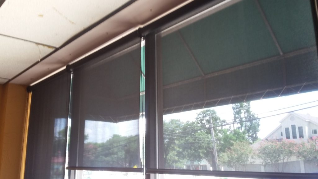 Example of black commercial window shades. Installed in Central Austin.
